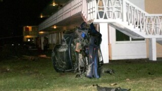A BMW flipped over outside the Lakeside Point Gardens Apartments in Lake Worth Beach on March 1, 2021.jpg
