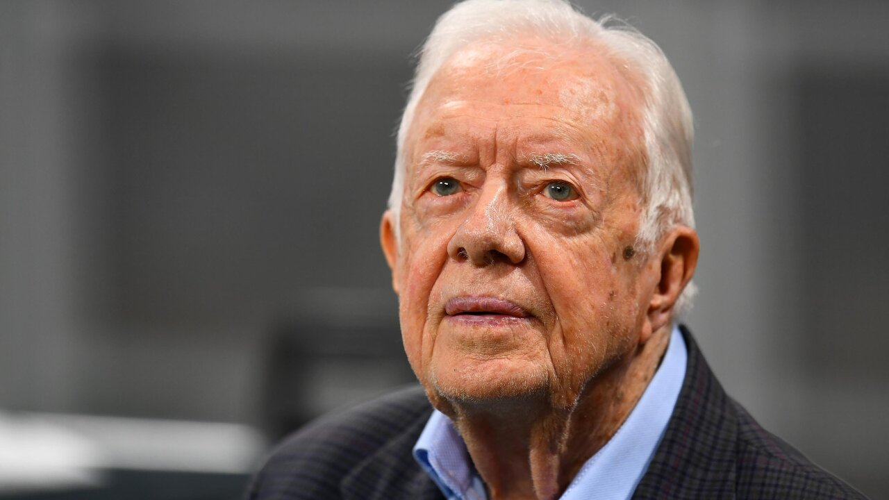 Jimmy Carter tells church service he is 'absolutely and completely at ease' with death