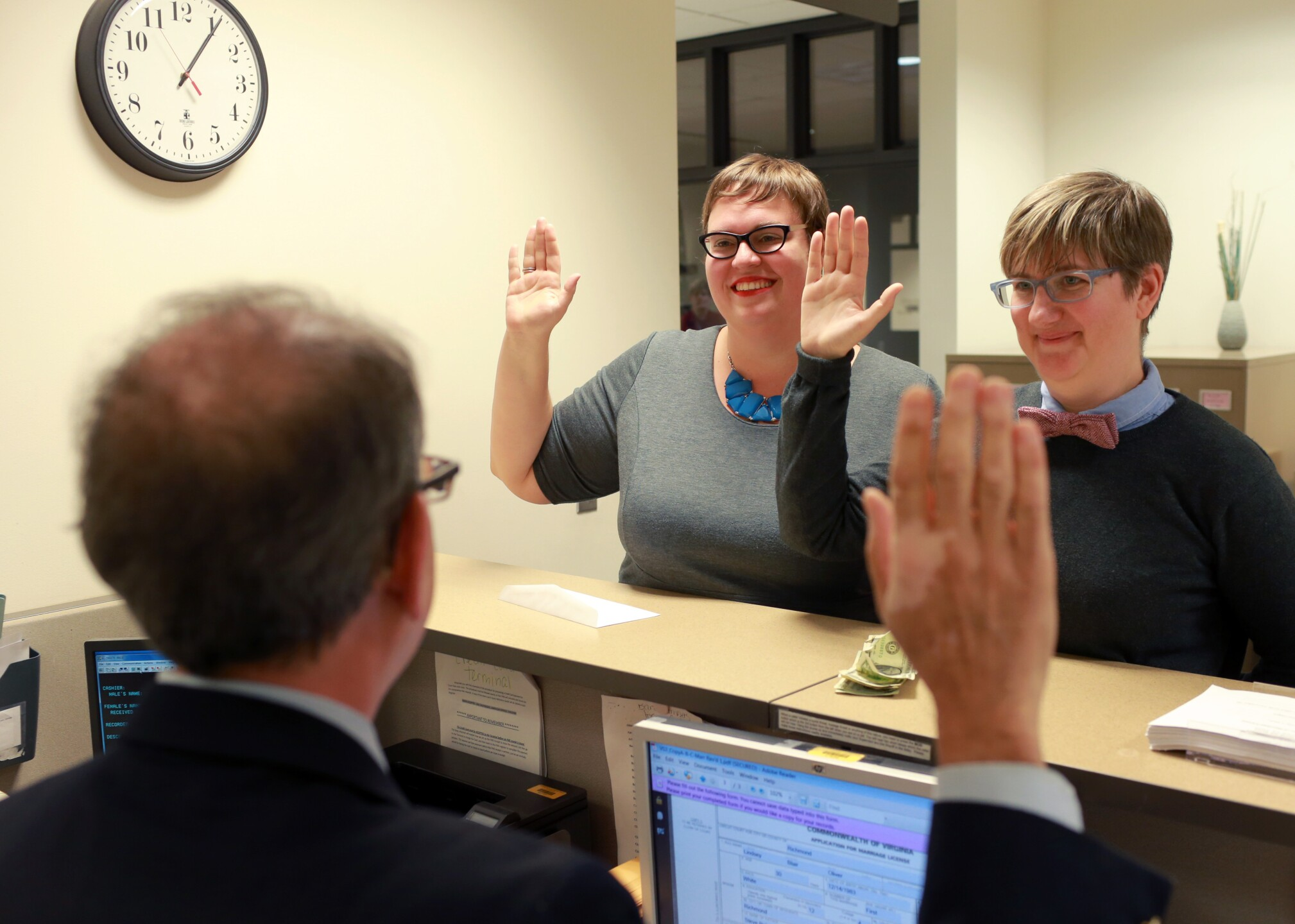 Photos: Same-sex couple exchanges marriage vows in ceremony outside Richmondcourt