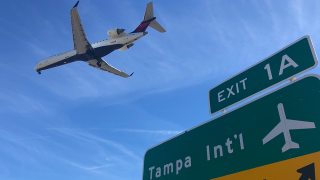 tampa-international-airport-exit-sign-delta-plane.png