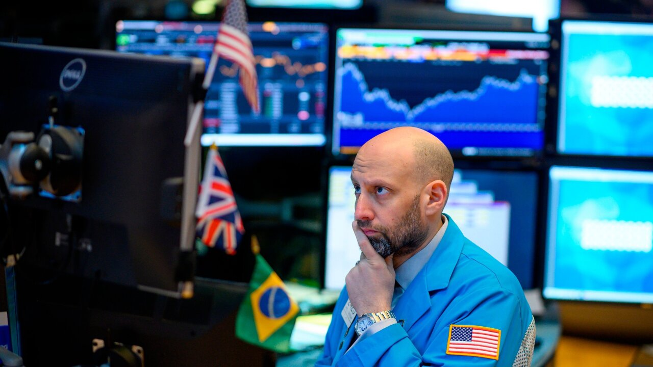 Dow tumbles 400 points after bond market flashes a recession warning
