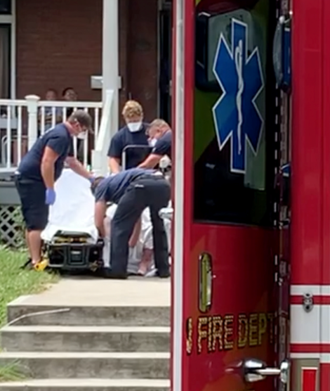 Covington firefighters assist a patient