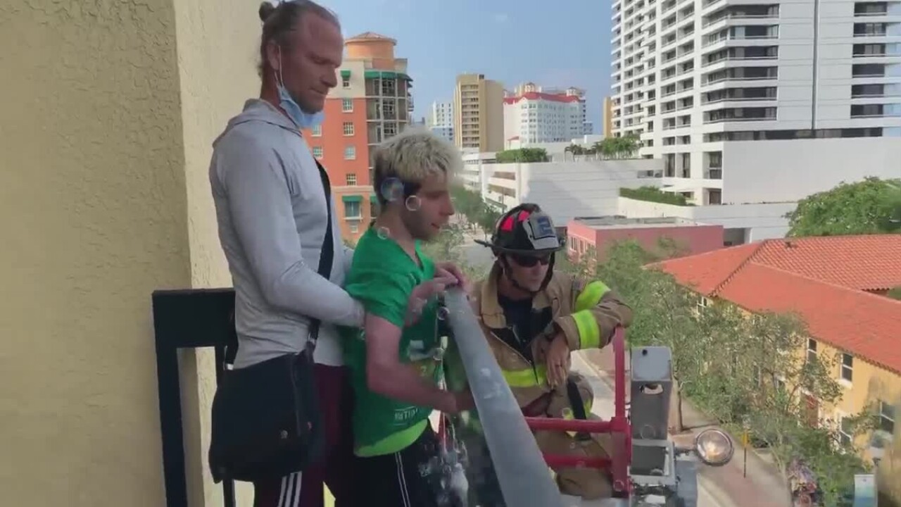 wptv-west-palm-beach-firefighter-surprise.jpg
