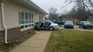 Car into Coloma Township Hall on election day