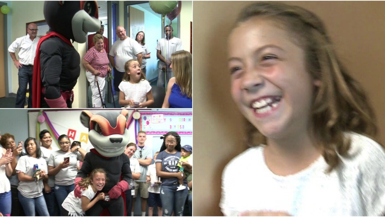 Group throws surprise birthday party for a soldier'schild