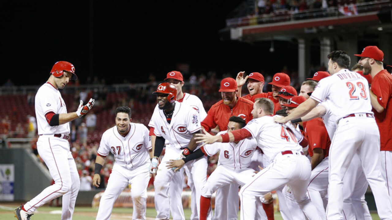 Votto homer takes Reds over Cardinals, 7-6