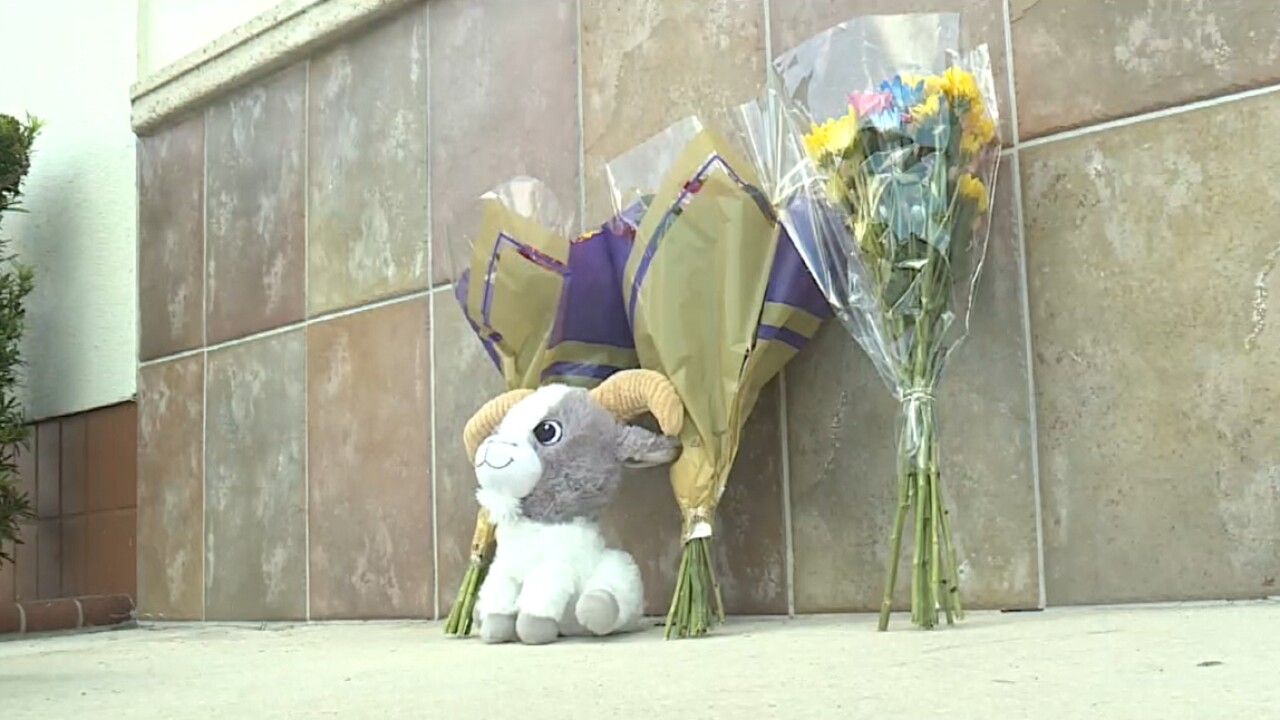 A memorial outside a Publix store in Royal Palm Beach on June 11, 2021.jpg