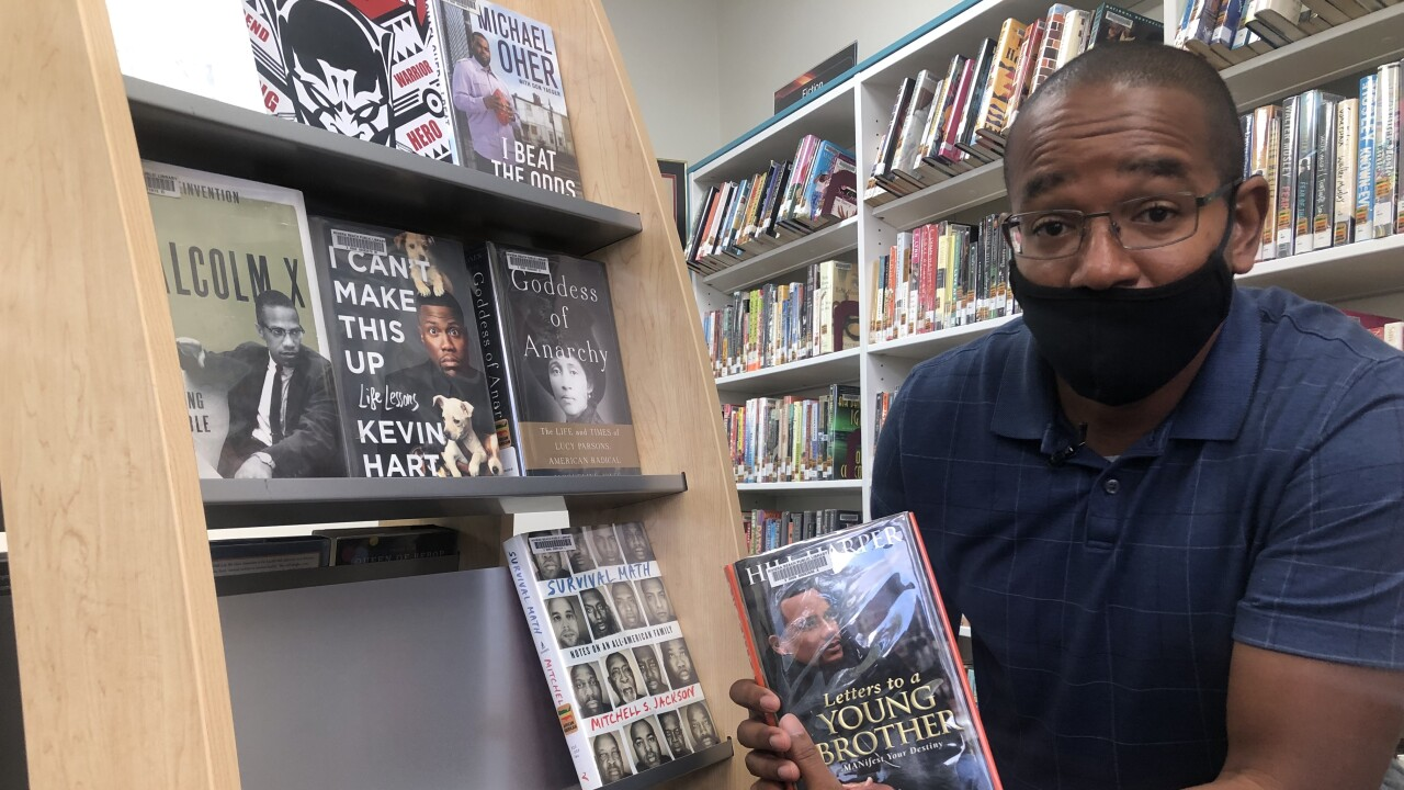 South Florida library director is adding his name and diversity to the shelves.
