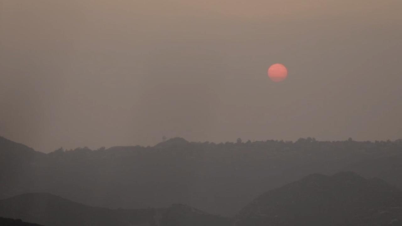 Residents near California wildfires battle hazardous air quality