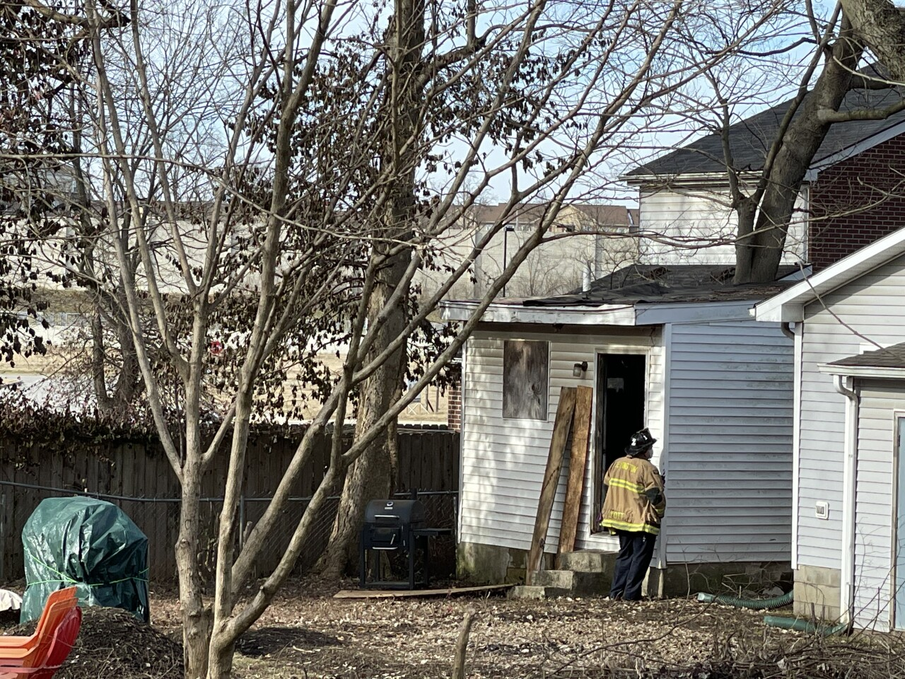 Firefighters work to rescue person trapped inside collapsed home