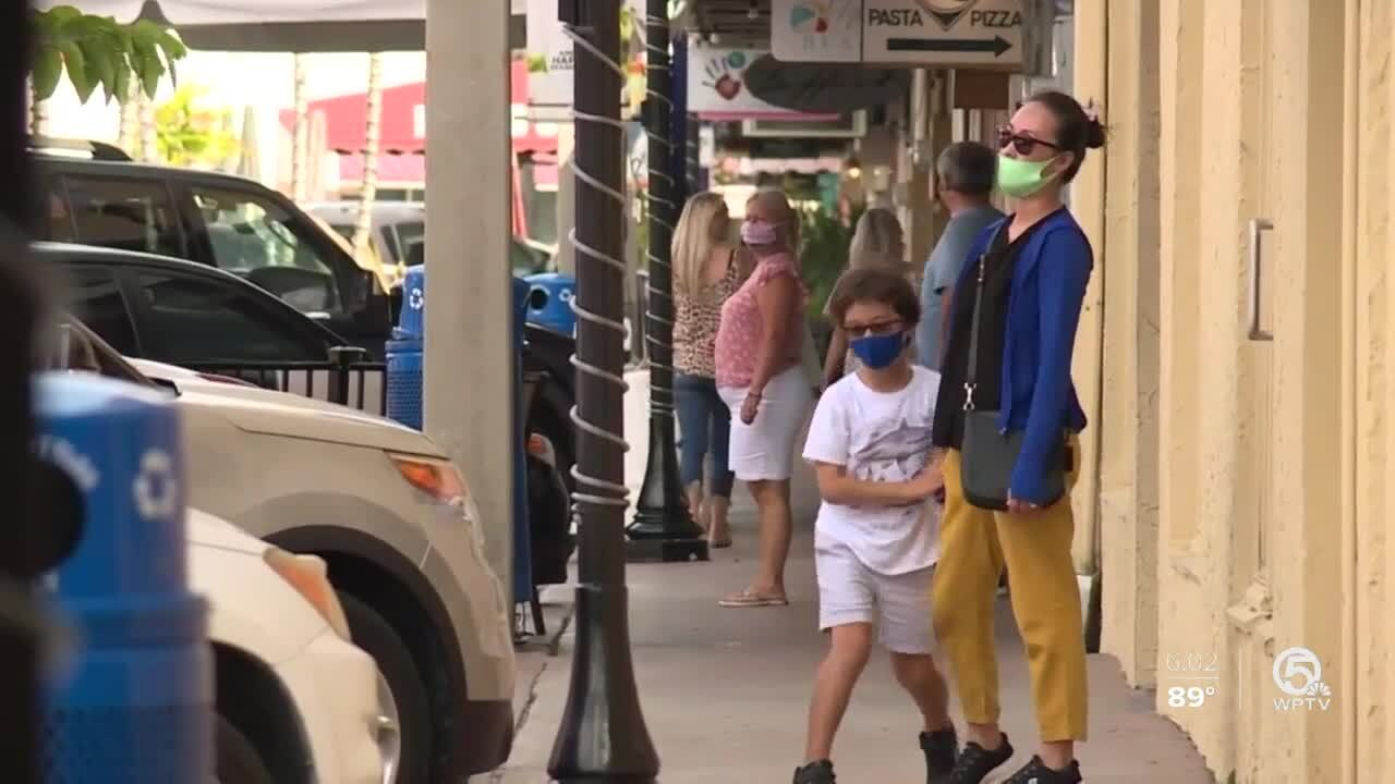 People wearing masks in downtown Stuart after requirement expired