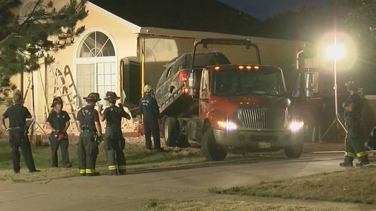 Car crashes into Denver home Tuesday night, nobody injured