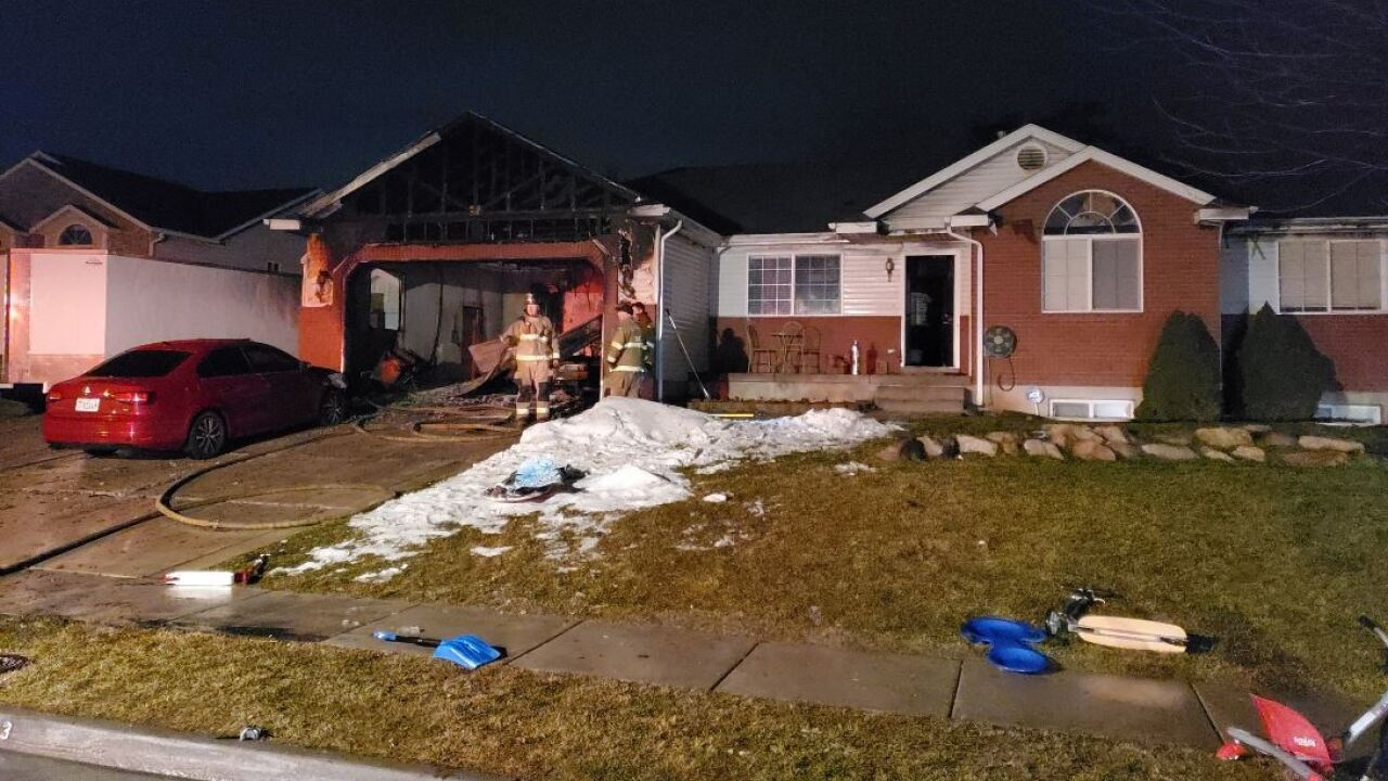 House fire in Clinton destroys multiple vehicles, displaces family