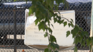 Community takes legal action against proposed drive-thru project