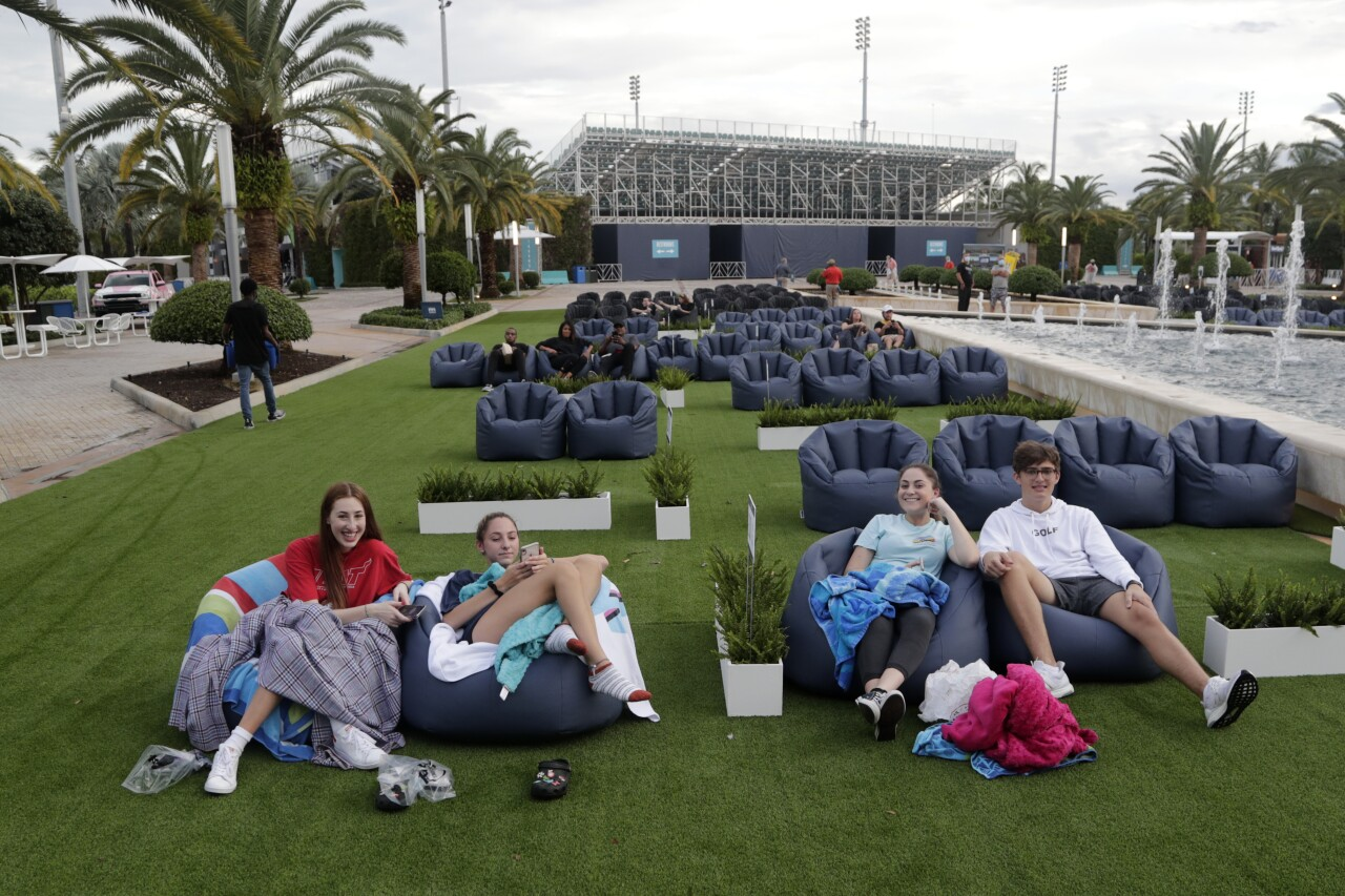 People watch movie outside Hard Rock Stadium