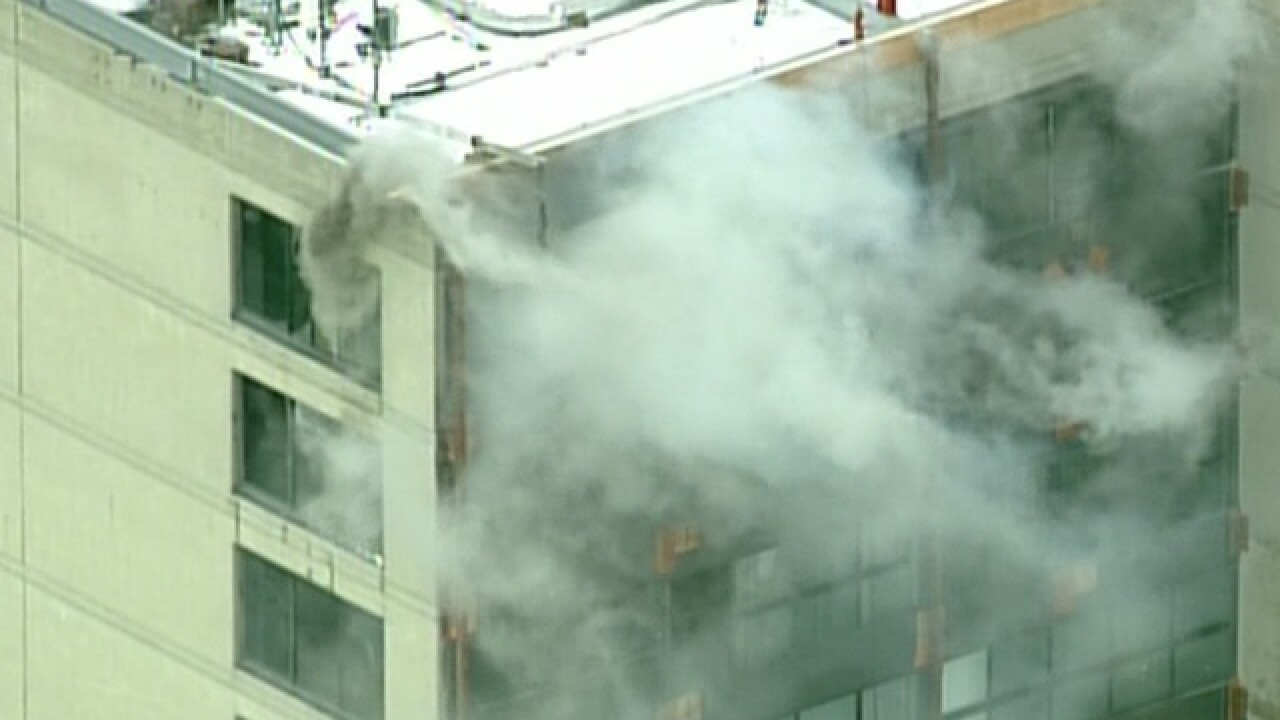 Crews on scene of fire at 555 Building