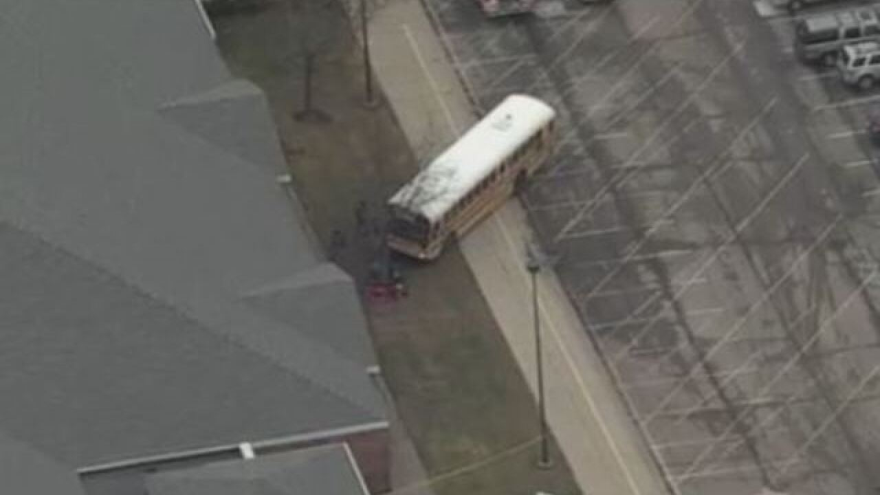 School bus crashes at school, several hurt