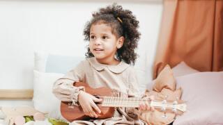 kid playing music generic