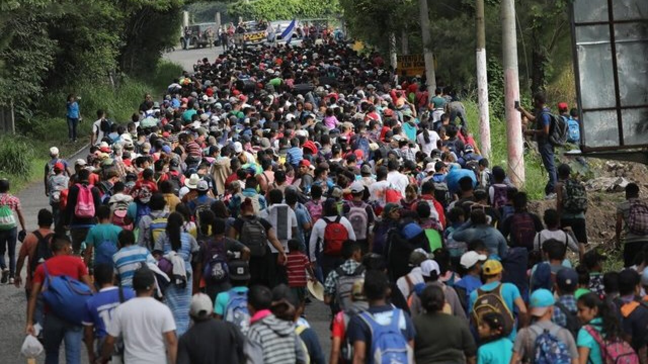 Chaos erupts as caravan reaches Mexico border