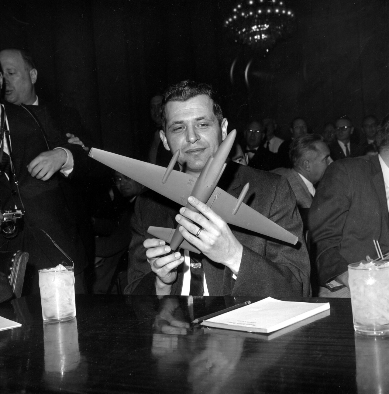 U-2 spy plane pilot Francis Gary Powers sits in the witness chair of the Senate Armed Services Committee in Washington, D.C. on March 6, 1962. This is his first public appearance since release by the Russians on Feb. 10. He is holding a U-2 model plane. (AP Photo)