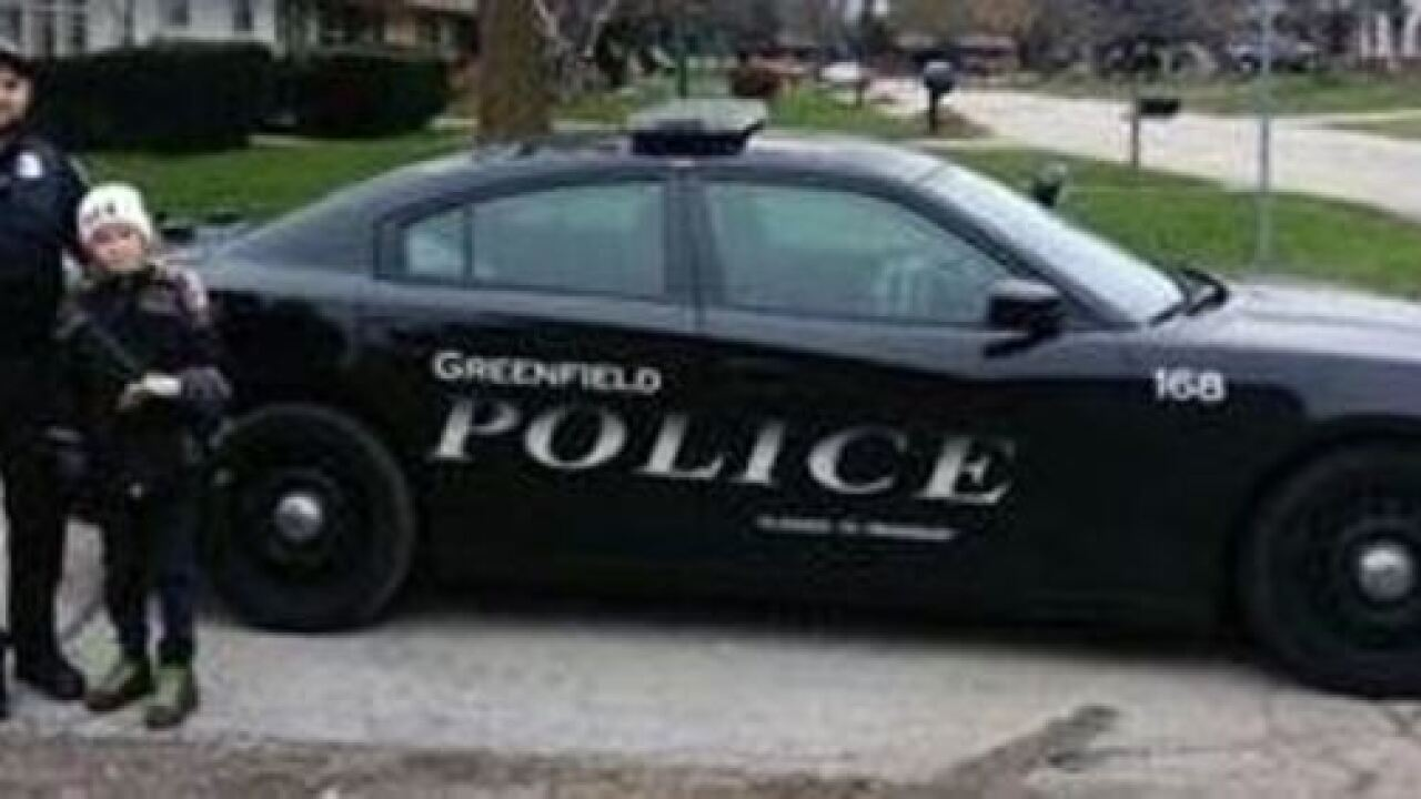 Greenfield police officer saluted for going the extra mile