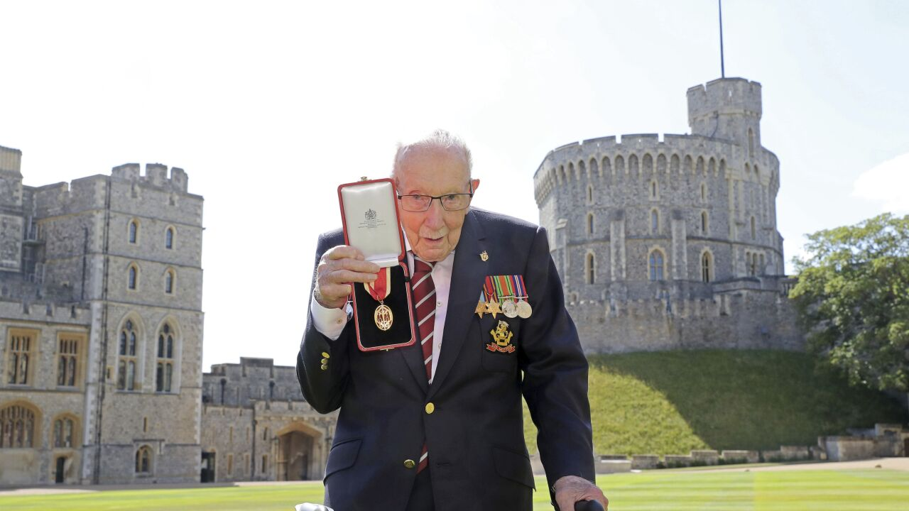 Queen knights 100-year-old veteran who raised millions for NHS during pandemic