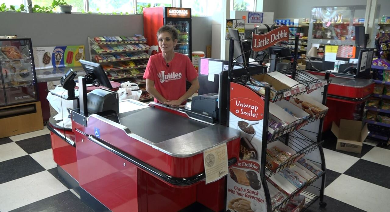 Darla once homeless is now working at a grocery store.