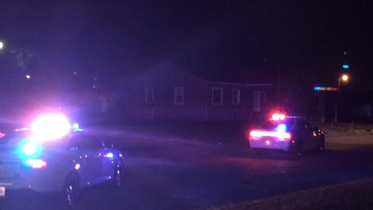 Child wounded by gunshots fired into a house