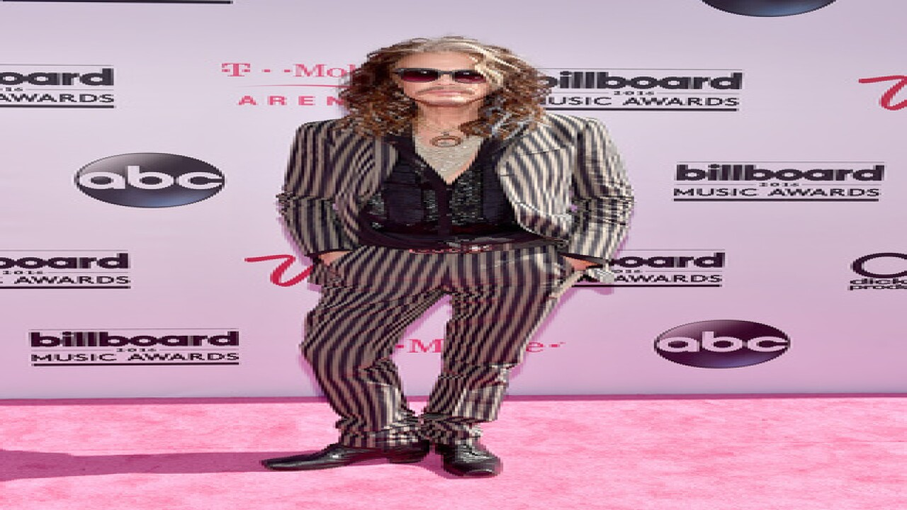 See best, worst looks from BBMA magenta carpet