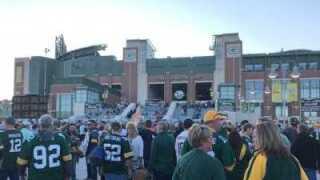 Fans standing outside of Lambeau Field in Green Bay, Wisconsin