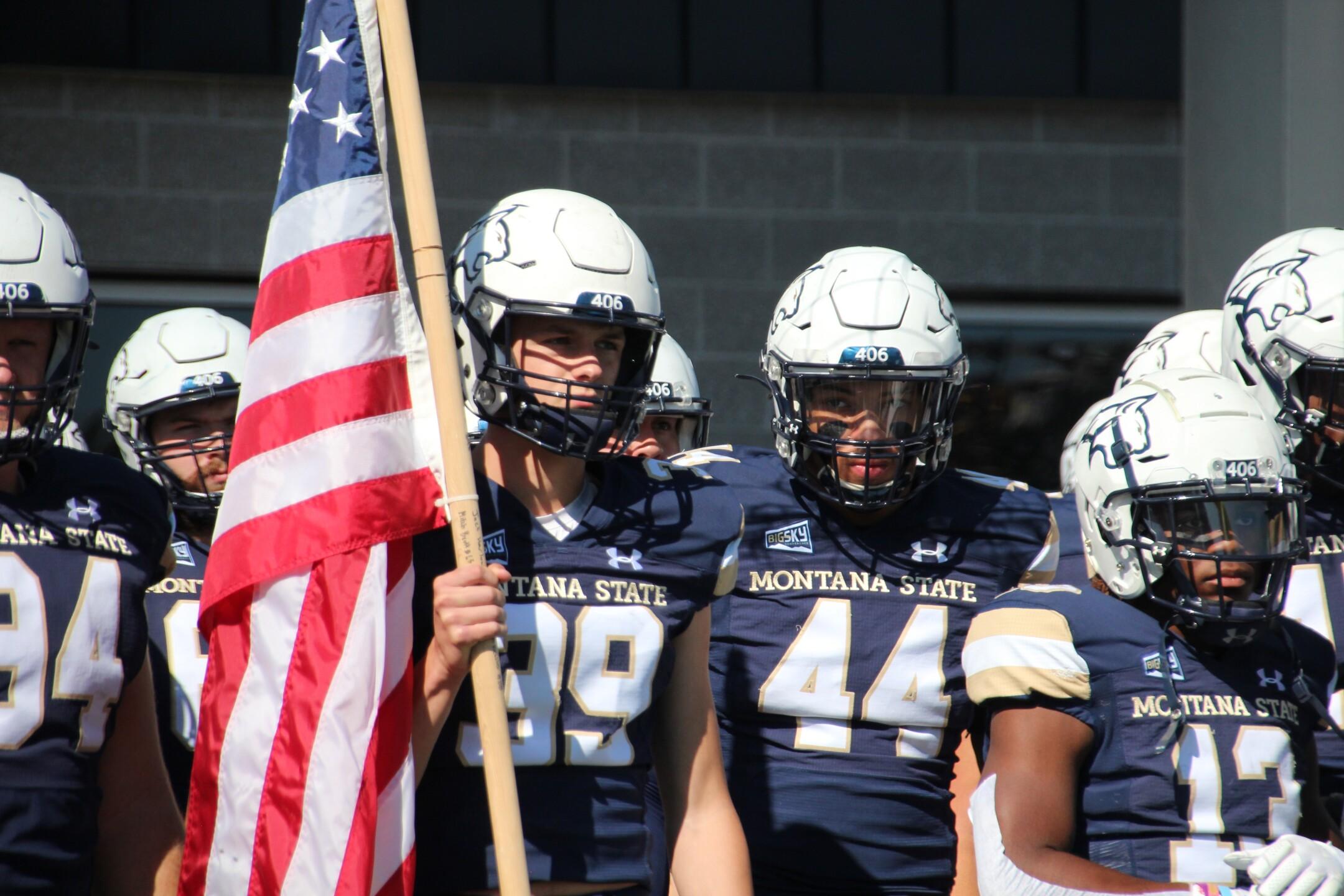 Blake Glessner carries the American Flag