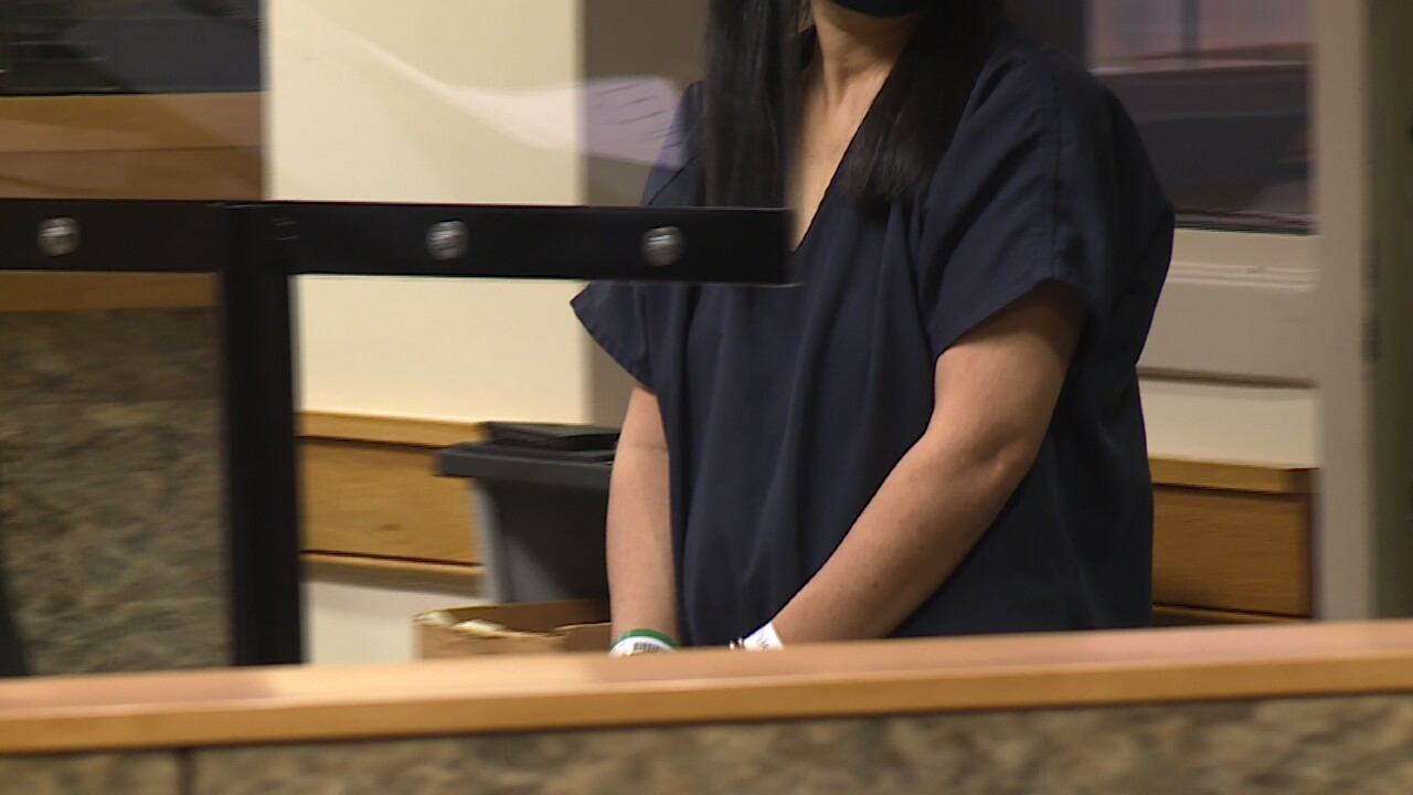 Mei Zhu Cheung, 46, appears in Palm Beach County court on Sept. 27, 2021.jpg