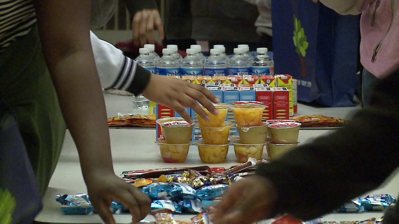 'Happy to be a part of it,' foster teens make care packages for the homeless