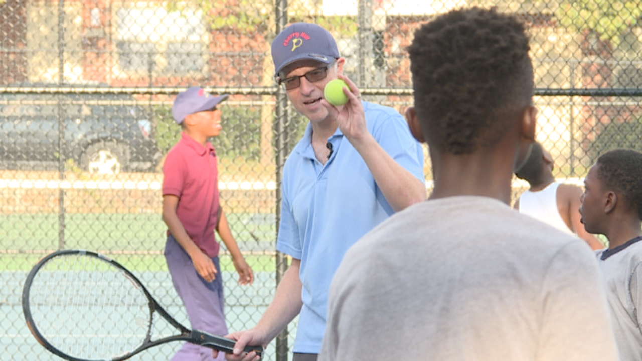 Doctor changing lives through the game of tennis