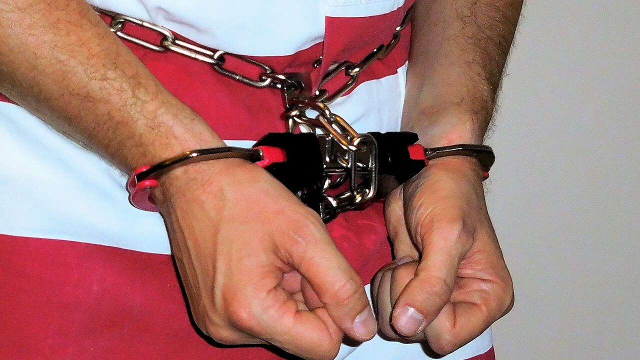 Inmate's Shackled Hands
