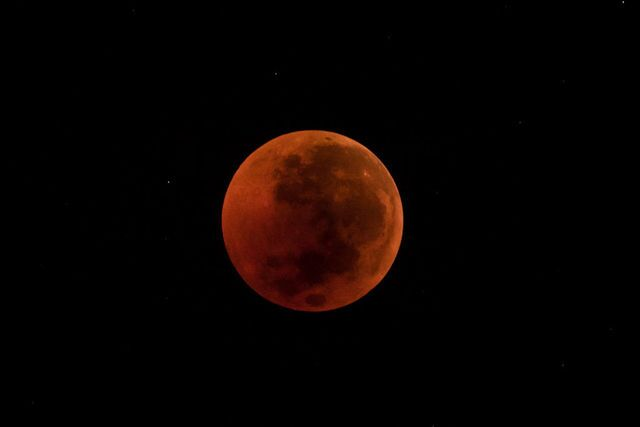 Photos: Lunar eclipse offers thrilling views of 'blood moon' across the world