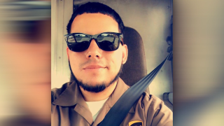 The UPS employee who died after his truck was hijacked was covering the route for another driver, brother says
