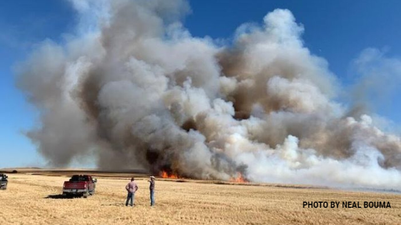 A wildland fire scorched more than 1,000 acres west of Dutton on Wednesday afternoon.