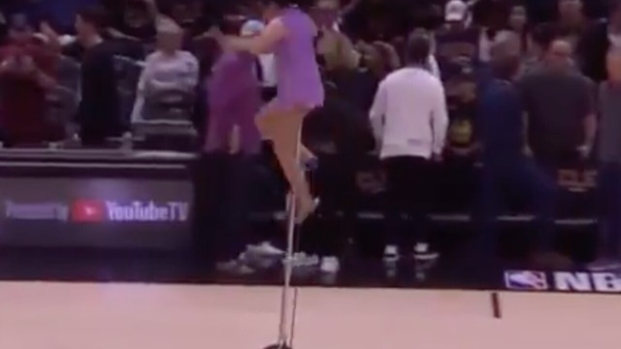 Red Panda falls off unicycle at halftime of NBA Finals