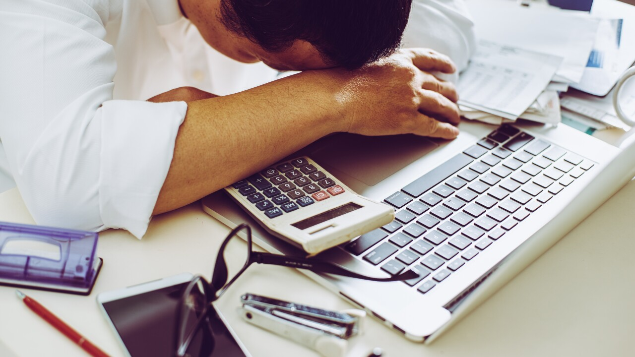 graphicstock-accountant-businessman-working-in-office-having-a-stress_BOkxBD3vejl.jpg
