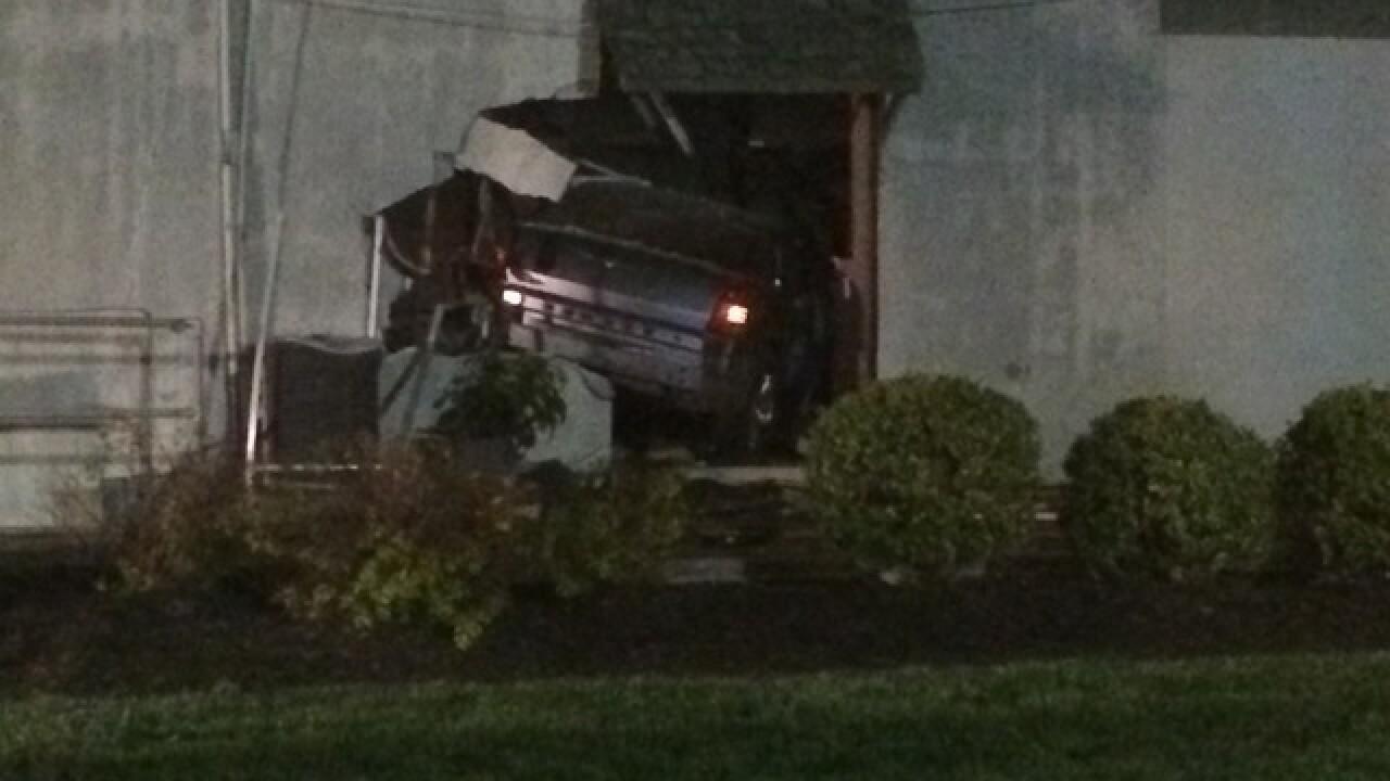 Chain-reaction crash sends car into florist shop