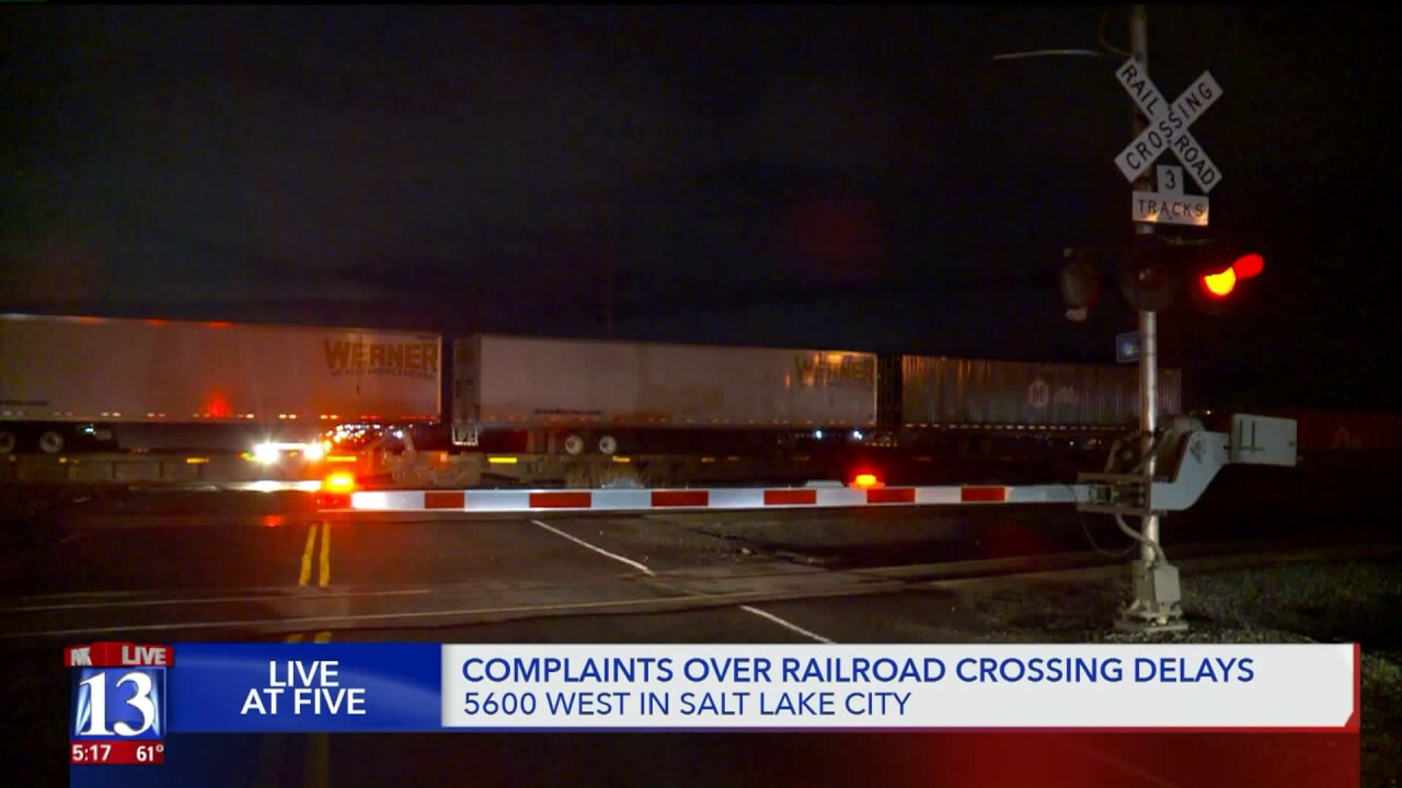 Commuters on 5600 West frustrated by long stops as trains block road at crossing