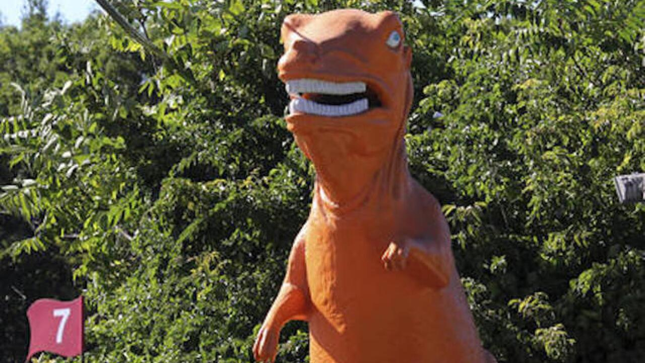 Orange dinosaur at mini golf course saved from extinction