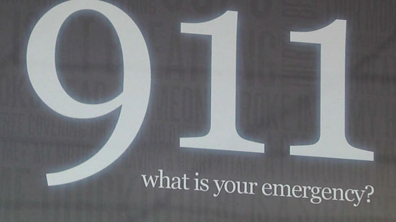 """911. What is your emergency?"" sign"