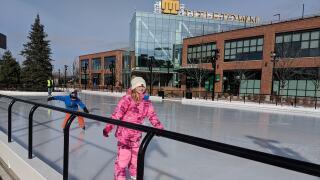 Titletown Ice Rink skaters for opening in November 2019.jpg