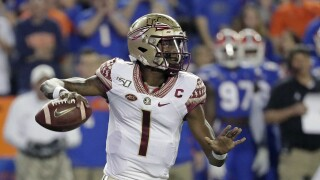 Florida State Seminoles QB James Blackman passes against Florida Gators in 2019
