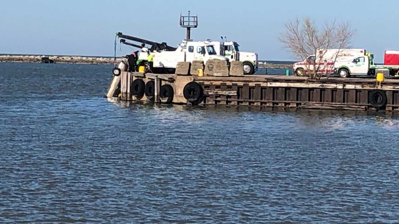 Gold car pulled from Lake Erie missing friends