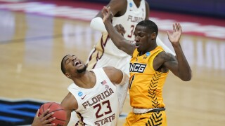 Florida State Seminoles guard MJ Walker goes to basket vs. UNC Greensboro in 2021 NCAA tournament