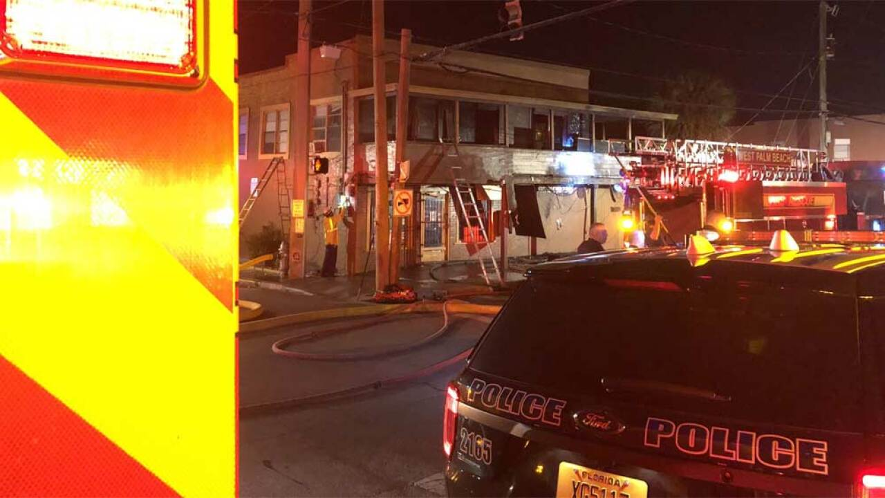 Fire at a building in the southeast corner of Palm Beach Lakes Boulevard and Sapodilla Avenue on April 15, 2019.