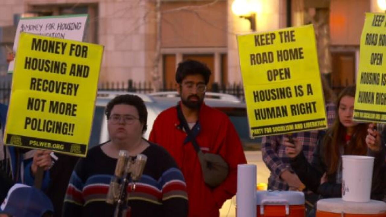 People rally outside the Road Home shelter; ask that it stay open through the winter